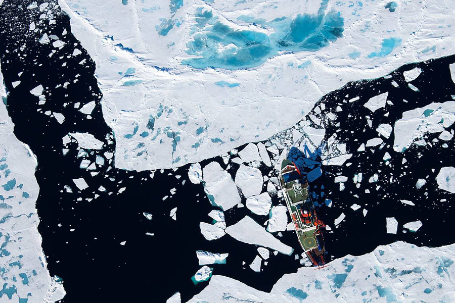 Aerial photograph showing a research icebreaker in the Arctic Ocean
