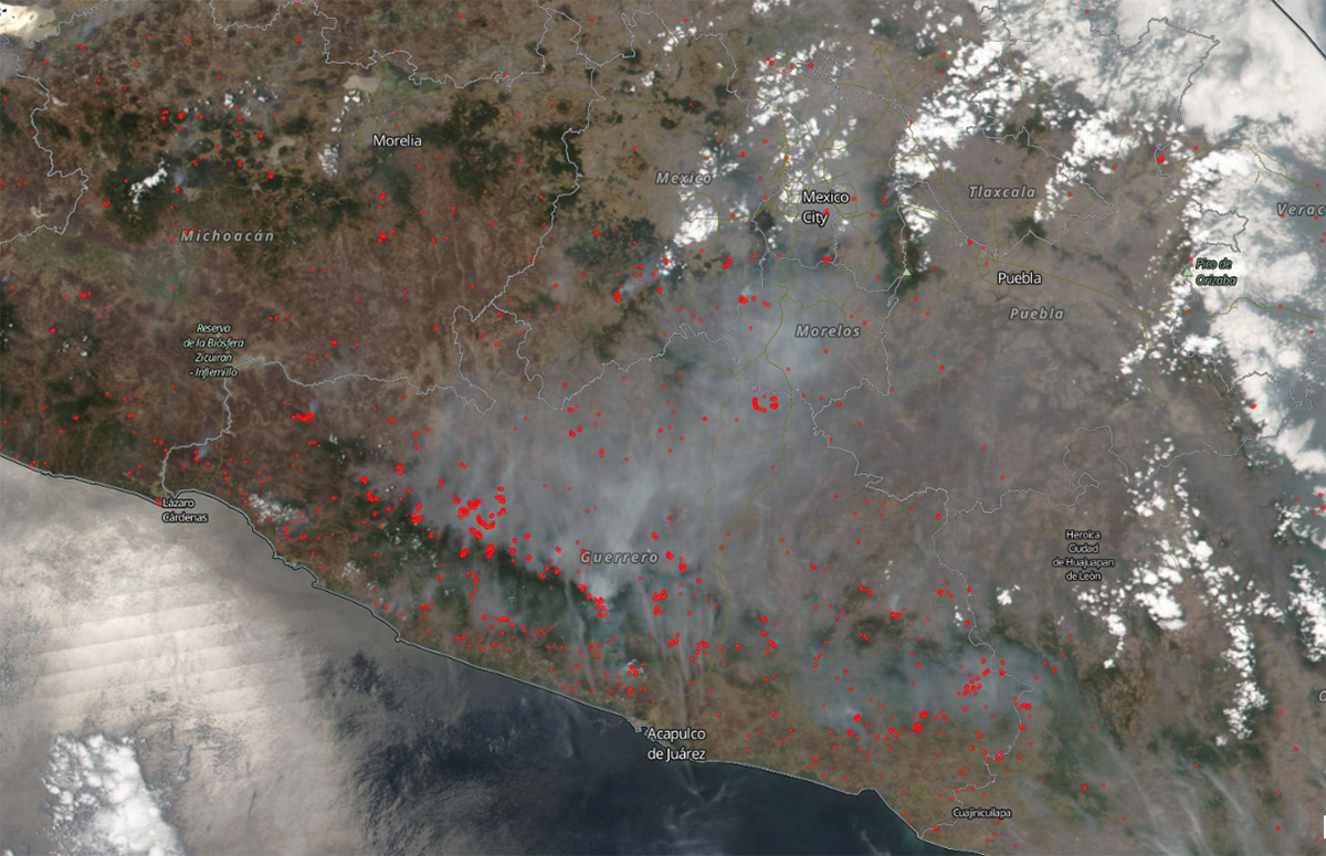 True color image showing south west Mexico with red dots to show where high temperatures were detected by VIIRS.