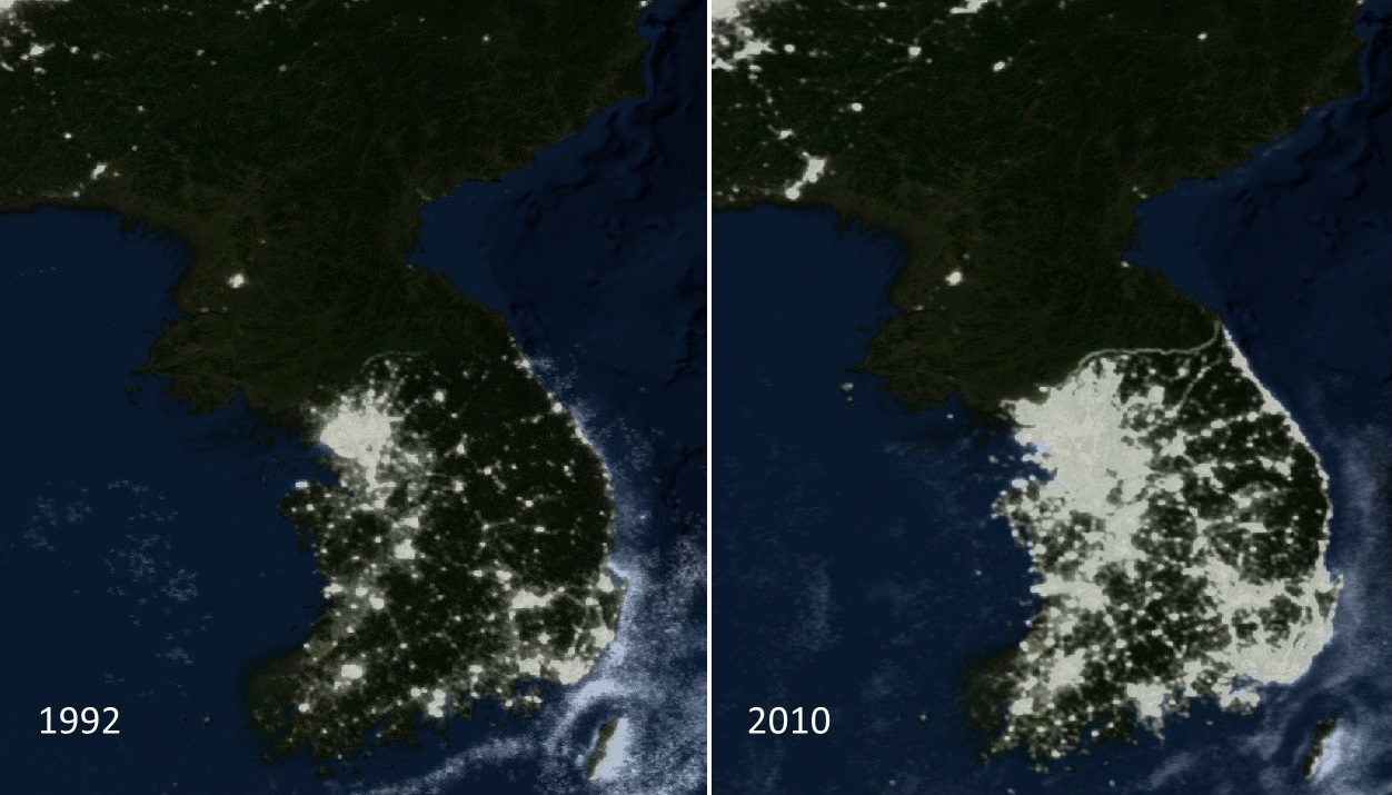 DMSP nighttime lights images from 1992 and 2010 showing changes in nighttime lights over the Korean Peninsula. The bright lights of South Korea contrast with the absence of lights in North Korea; also an increase in lights in clearly seen in South Korea over this time period.