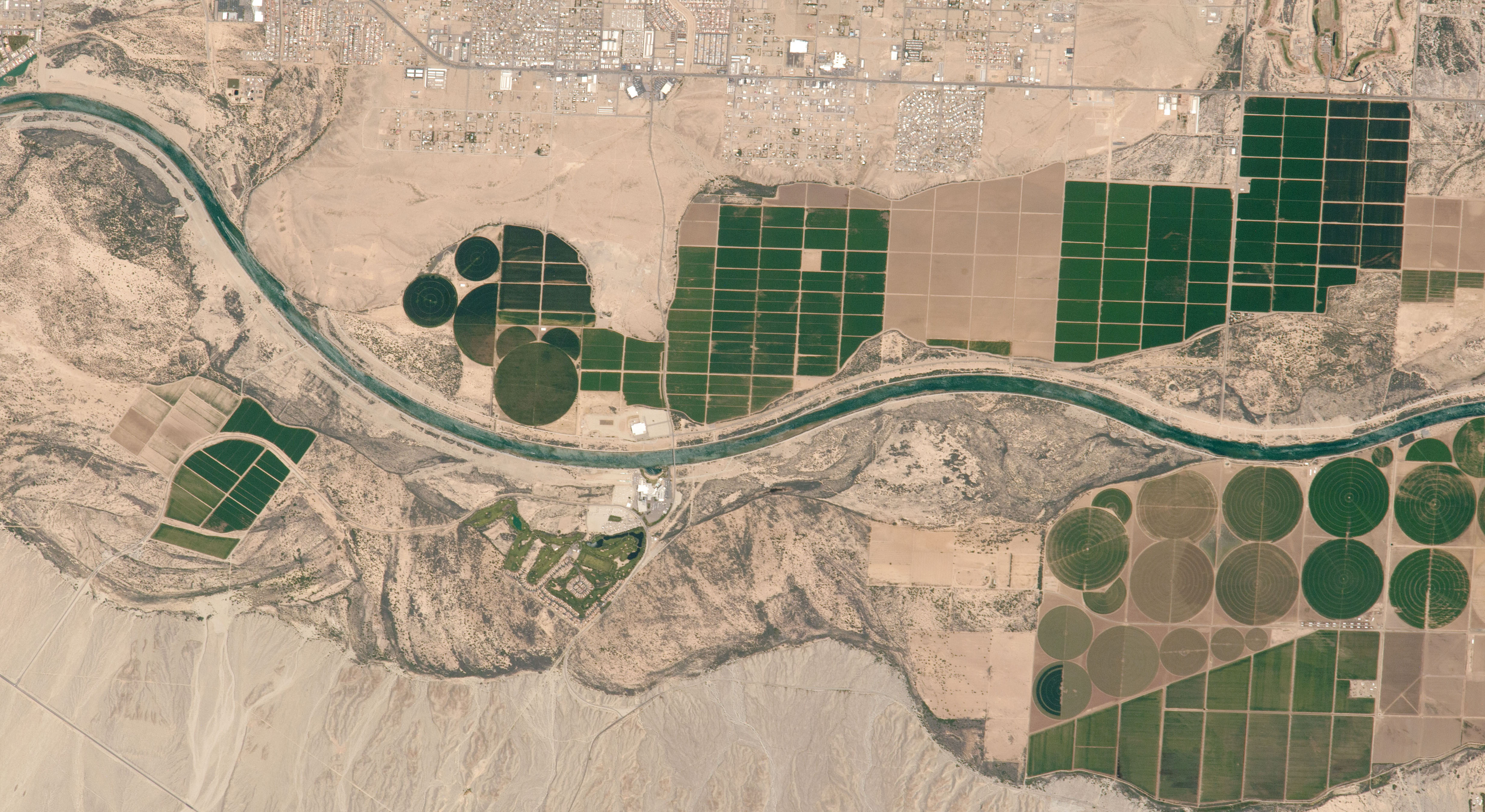 Farms rise from a floodplain where the Mojave nation meets Arizona, Nevada, and California. Astronaut photo ISS051-E-13172 was acquired on April 14, 2017 aboard the International Space Station. I