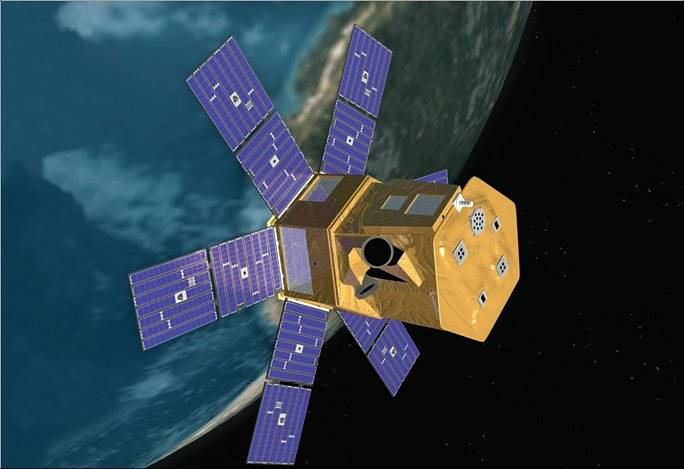 Image of SORCE satellite with six solar panels coming off a rectangular gold-covered bus. Earth is in the background.
