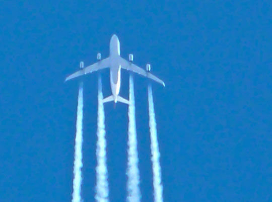 Photograph of an aircraft and contrails