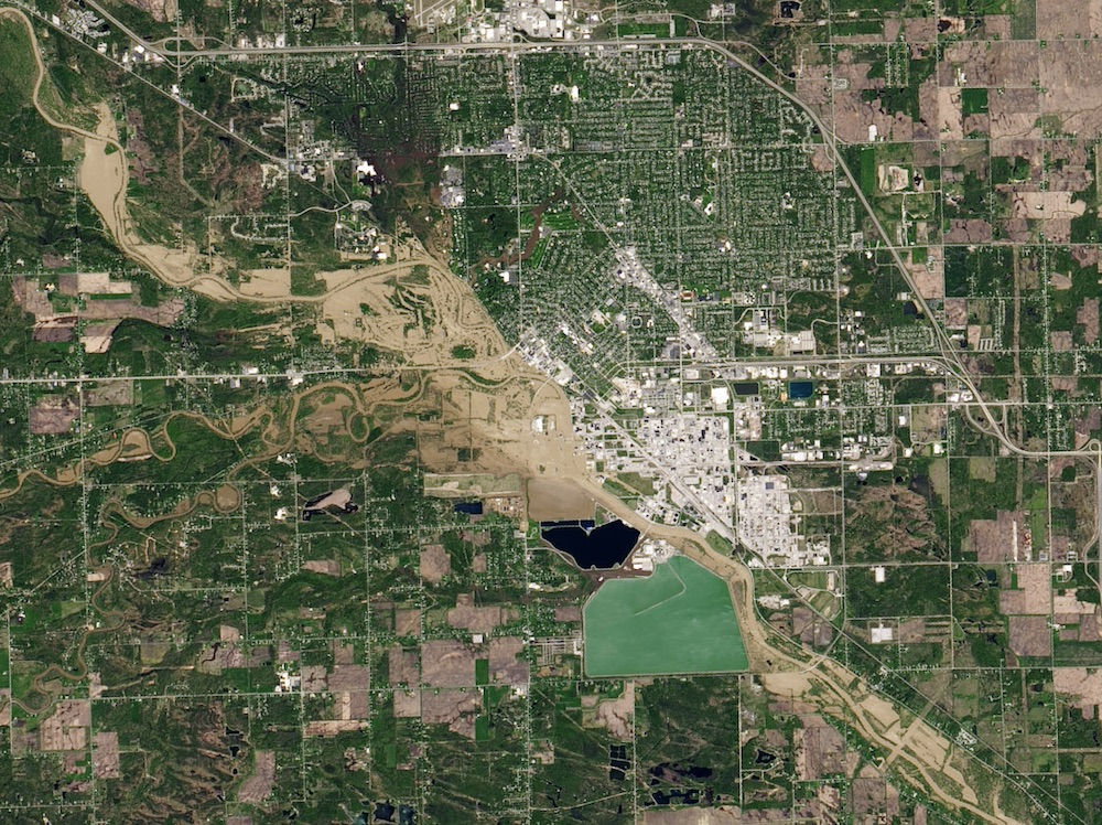 Two days of heavy rain, May 2020, led to catastrophic dam failures and major flooding in Midland County, Michigan. The natural-color image is from Landsat's Operational Land Imager.