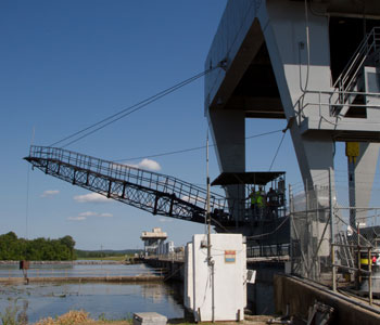 Photograph of river control structure and a crane