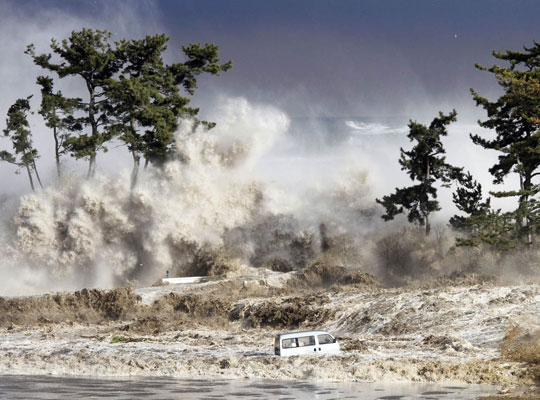 Photograph of a tsunami striking the northeastern coast of Japan