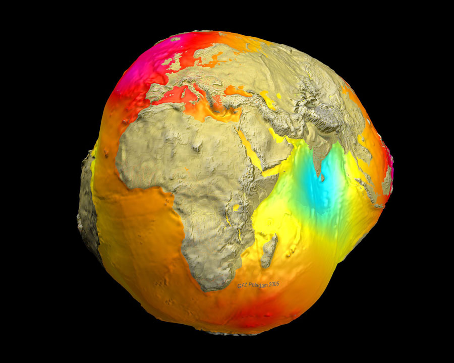 Colored image of Earth depicting areas of different mass concentrations. Resulting shape is like a potato, with red indicating areas of higher gravity (mass) and blue/green indicating areas of lower gravity (mass).