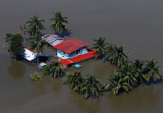 Floods engulfing a house in Bangkok, Thailand