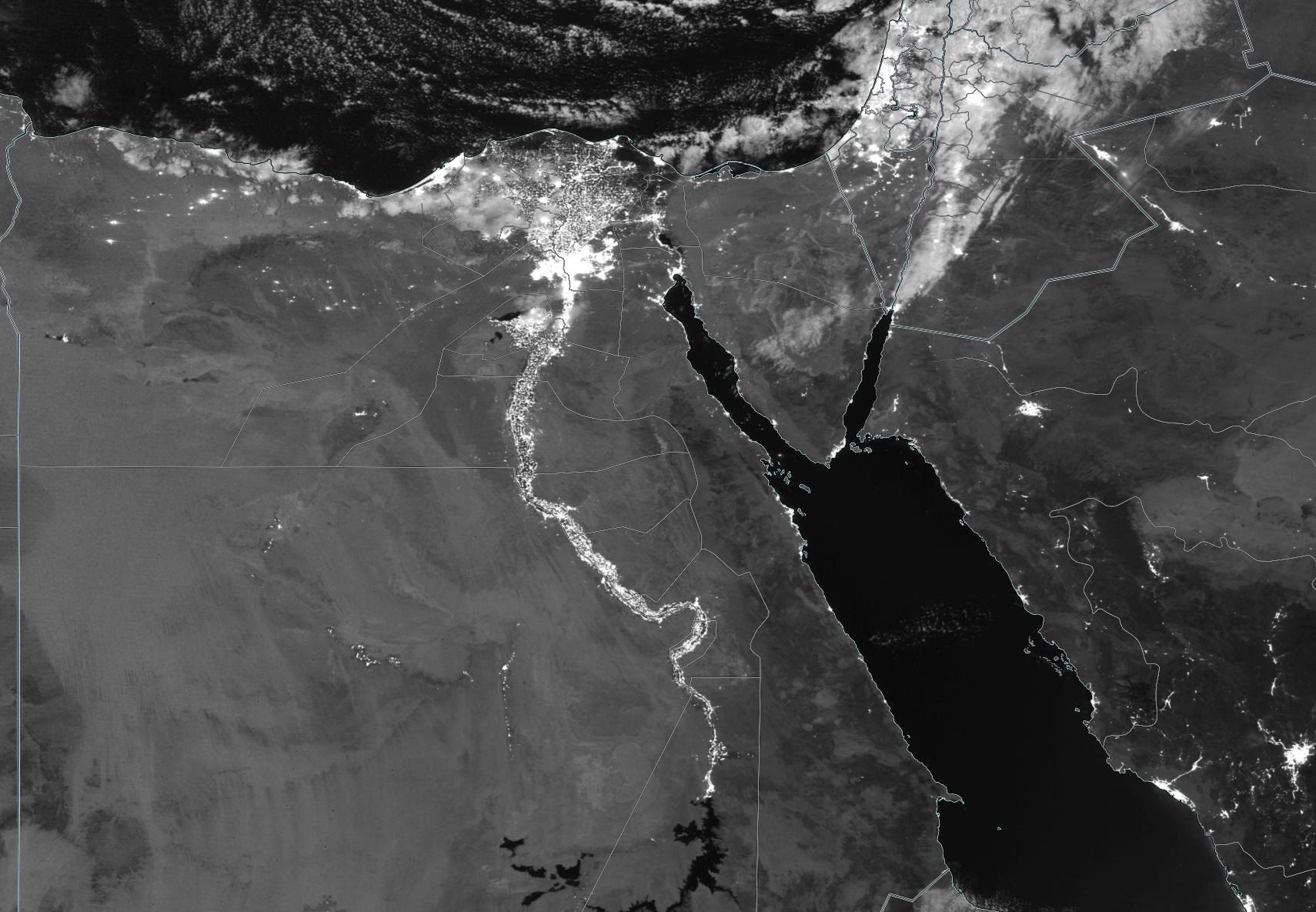 Black and white image of Egypt and the Nile Valley showing bright lights along the Nile and Cairo on the Mediterranean Sea.