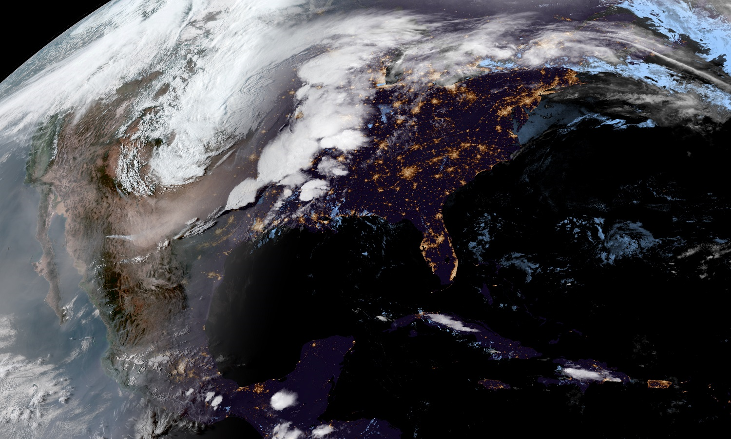 Color image of the U.S. showing bright white clouds along a frontal system across the central U.S. and brown dust behind the front in the desert Southwest.