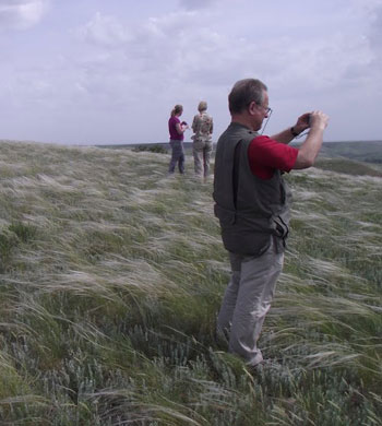 Photograph of researchers in a Russian grassland