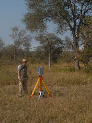 Photograph of a research laser scanning a savanna landscape