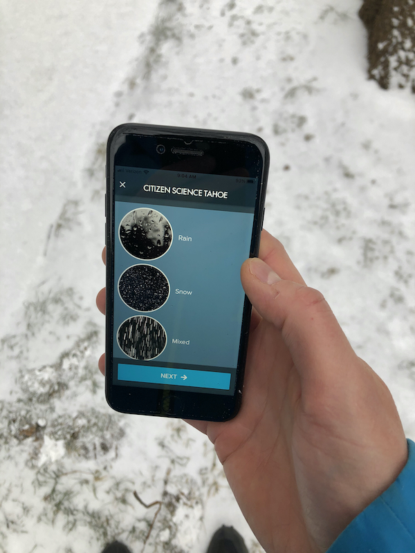 Image of hand holding a cell phone with a page to enter precipitation type (rain, snow, mixed).