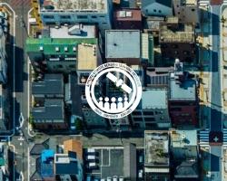 ARSET logo over remote sensing image of city for Population Grids Training