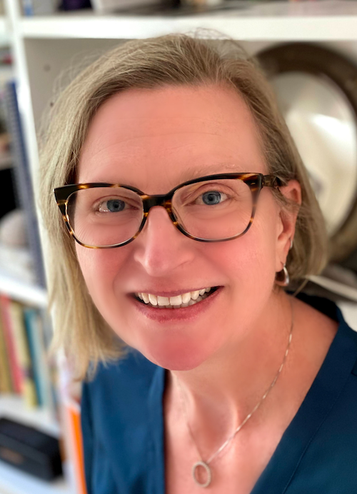 Headshot of Dr. Chelle Gentemann sitting in front of a bookcase.