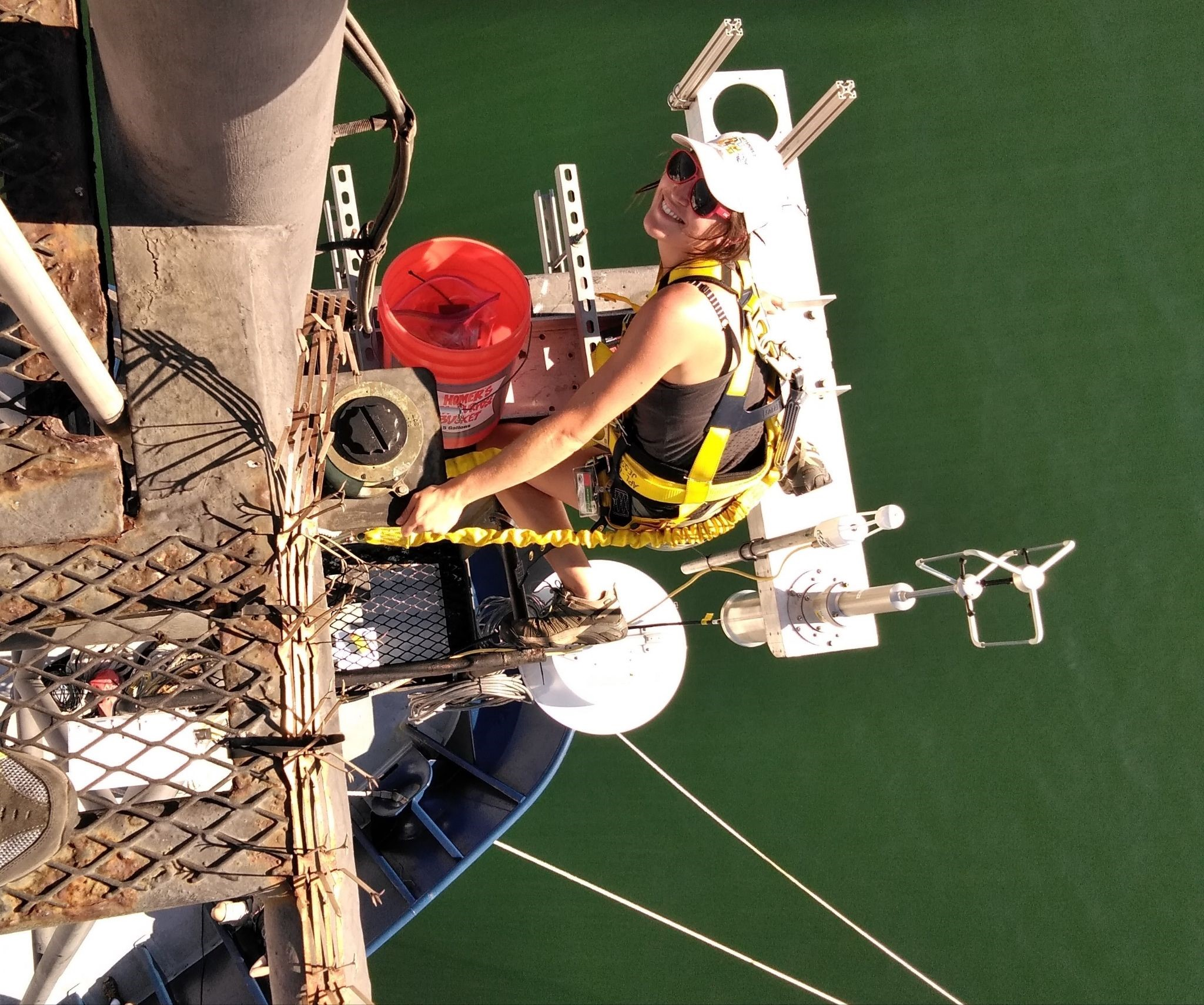 Kyla Drushka installs a disdrometer, an instrument that measures the size of individual raindrops, on mast of the ship R/V Revelle during the SPURS-2 project.