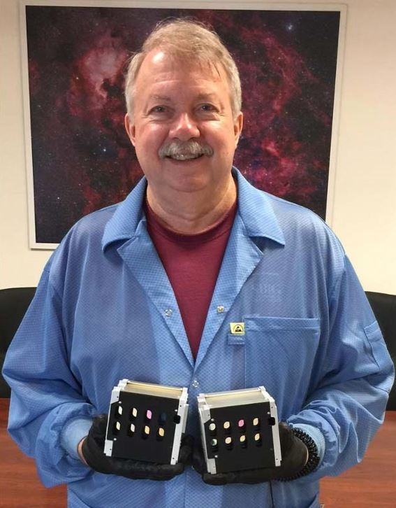 Dr. Alan Holmes holding two HawkEye imagers