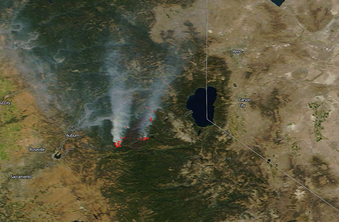 Figure 2: LANCE, GIBS, and Worldview enable events like wildfires to be observed in near real-time, such as this image of California's King Fire from September 24, 2014. Red dots are hotspots detected by the MODIS instrument aboard the Aqua and Terra satellites. White areas are smoke. Lake Tahoe is to the right. (Image courtesy of NASA Worldview)