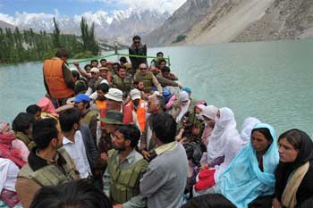 Photograph of a ferry full of people crossing Lake Gojal