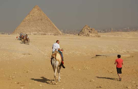 Photograph of people approaching smog-blanketed Cairo