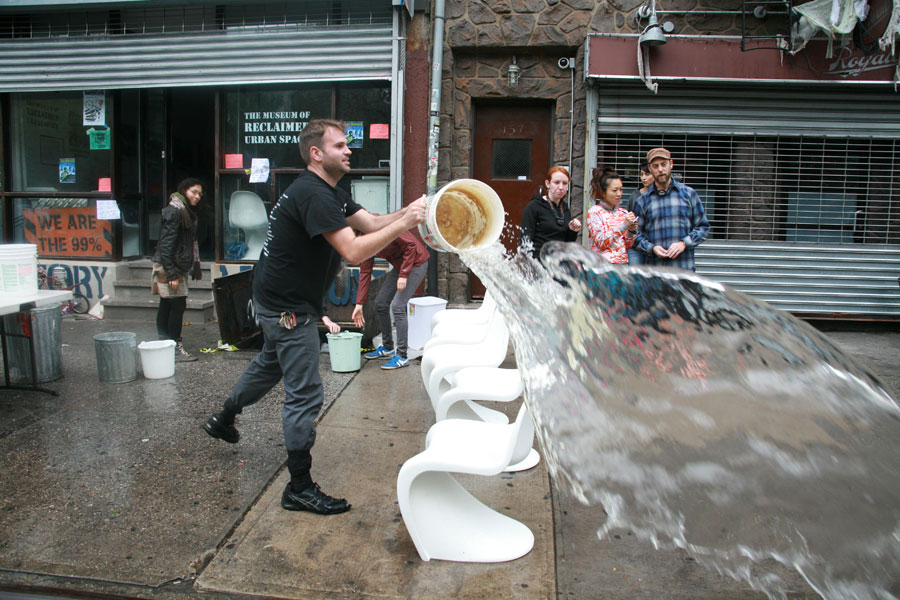 Photograph of volunteers bailing water out of a museum in New York City after Hurricane Sandy