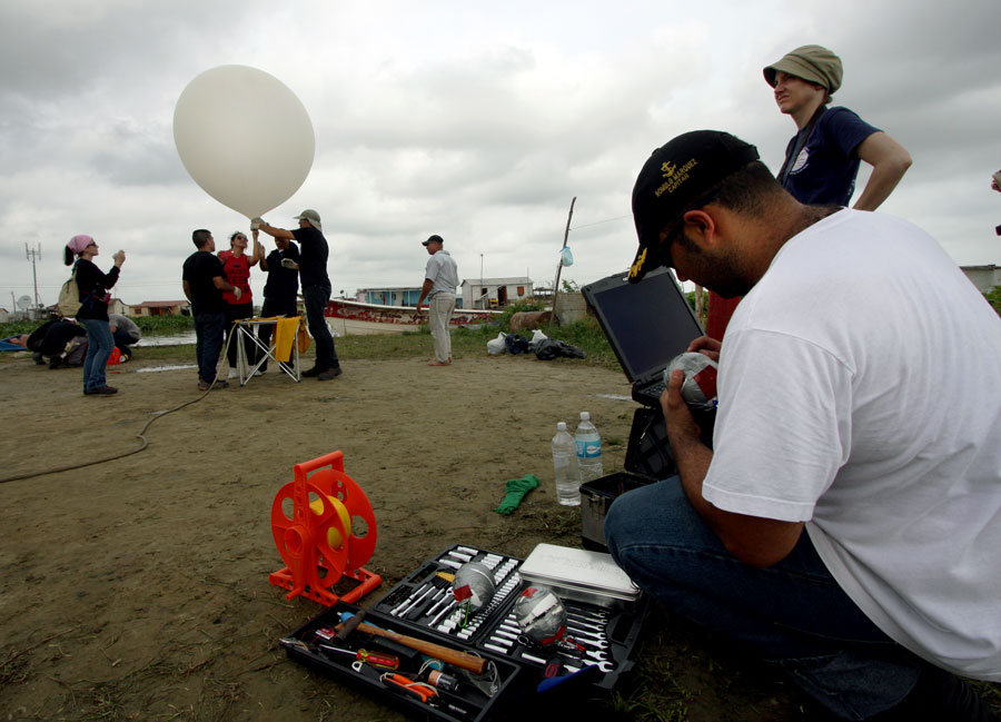 Photograph of researchers preparing to deploy a weather balloon