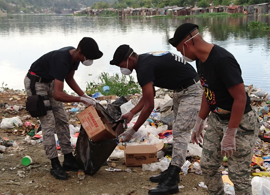 Photograph of workers picking up trash