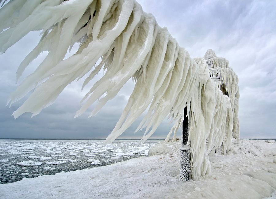 Photograph of an iced-over catwalk rail at a lighthouse