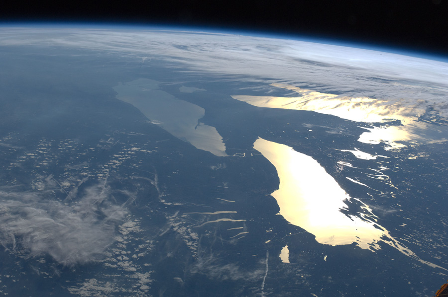 Aerial photograph showing several of the Great Lakes glinting in the sun